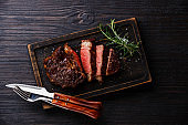 Sliced grilled meat barbecue steak Rib eye with knife and fork