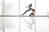 Woman yoga Practice Pose Training Concept against panoramic windows