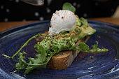 poached egg and avocados on sourdough