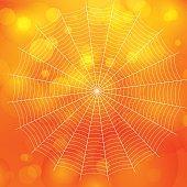 orange blurred bokeh halloween background with spiders web, Vector