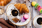 Coffee and croissants breakfast, flay lay style