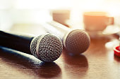 presentation concept, Microphone with coffee cup on table close-up