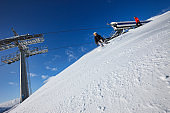 Young man snowboarder and  Woman skier skiing at sunny ski resort Dolomites in Italy Amateur Winter Sports