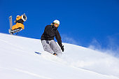 Young man snowboarder  snowboarding at sunny ski resort Dolomites in Italy Amateur Winter Sports