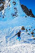 Boy skier playing in snow at ski resort Dolomites in Italy