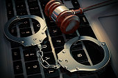 Cyber Crime Concept. Handcuffs and judge gavel on Laptop Computer. 3d Rendering