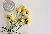 Yellow roses on table from above