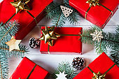 christmas decorations with christmas gifts on wooden background