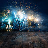 Firework display behind wooden table