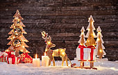 Christmas background with illuminated moose and christmas tree.