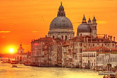 Sunrise in Grand canal with Church of Santa Maria della Salute, Venice, Italy
