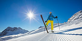 Skier on piste in sunny day. Skiing concept.