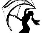 Silhouette of woman dancing with transparent fabric in black and white