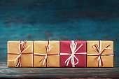 Gift boxes over blur wooden background