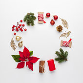 Frame made of christmas decoration on white background.