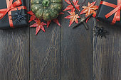 Top view / Flat lay Halloween 's pumpkin and accessories or items the leaf spider and gift / present on rustic wooden background.Idea for decoration / ornament to website banner  with copy space.