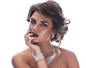 Gorgeous woman is wearing beautiful jewellery
