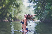 Sensuality young woman showering in the nature