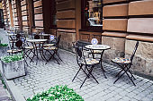Empty chairs in outdoor cafe or restaurant