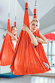 Fly yoga. two women practices anti-gravity yoga with hammock .