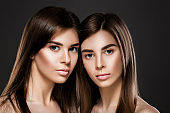 twins women with perfect skin and natural make-up