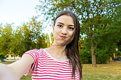 Beautiful urban crazy woman taking picture of herself, selfie.