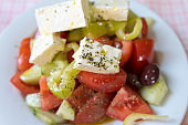 Real Greek salad on the table at a tavern in Greece