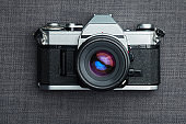 Old vintage film camera with lens on canvas