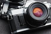 Old vintage film cameras on canvas