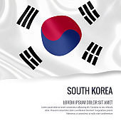South Korea flag. Silky flag of South Korea waving on an isolated white background with the white text area for your advert message. 3D rendering.