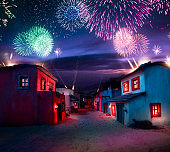 Scale model of a typical mexican village at night with fireworks