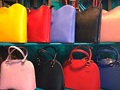 Colorful Purses For Sale On Shelf In Market