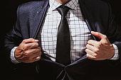 Businessman super hero on black background