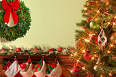 Christmas Tree Frames A Christmas Wreath Over Mantelpiece Adorned With Christmas Garland