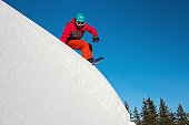 Shot of a snowboarder riding on dangerous slope on sunny winther day in the mountains copyspace extreme adrenaline danger activity youth seasonal sport concept
