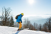 Professional skier enjoying skiing in mountains on a sunny winter day on the winter resort
