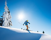 Full length shot of a professional freeride skier skiing on top of the mountain copyspace active people living leisure hobby extreme slope snow winter seasonal sport