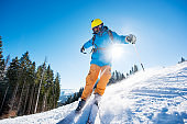 Shot of a freerider skier skiing in the mountains on fresh powder snow copyspace recreation sports winter resort equipment gear concept
