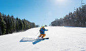Professional skier riding down the hill enjoying skiing in the mountains outdoors sport recreation extreme lifestyle people travelling resort concept