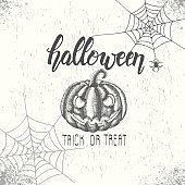 Halloween background with hand drawn Halloween pumpkin hand made lettering, spider and web.