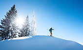Full length shot of a skier on top of the mountain, pointing to the sky. copyspace active people living leisure hobby extreme slope snow winter seasonal sport