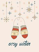 Cosy winter card with mittens and snowflakes in tribal style on pale-pink tone background.Season design.