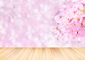 wooden table and blurred pink full bloom sakura Cherry blossom