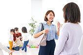 Business women taking children from kindergarten