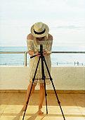 Woman photographer taking shot in Summer