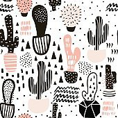 Seamless pattern with cactuses and hand drawn textures.Perfect for fabric,textile.Vector background