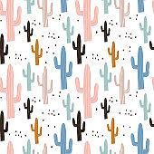 Seamless pattern with cactuses and hand drawn textures.Perfect for fabric,textile.Vector pastel background