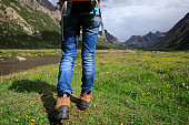 young backpacking woman hiking in mountains