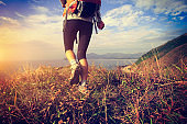 successful hiker on seaside mountain peak