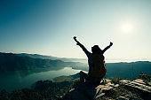 Successful woman backpacker on beautiful mountain top